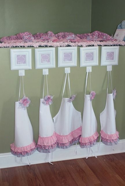 Aprons for a cupcake decorating party. My child will have a party like this as soon as she is able to do it. Holla.