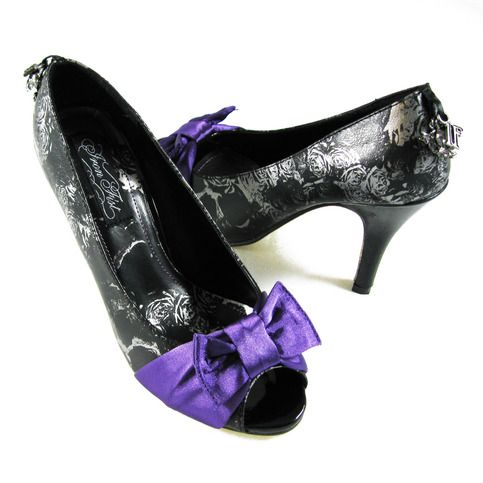 """Metallic charcoal platform heels by IRON FIST. Feature a subtle skull design, a purple satin bow,  and a sexy peep toe. They have a 4 1/2"""" heel with a 1"""" hidden platform.  100% Vegan.  For sizing information please check the sizing chart image to the left."""
