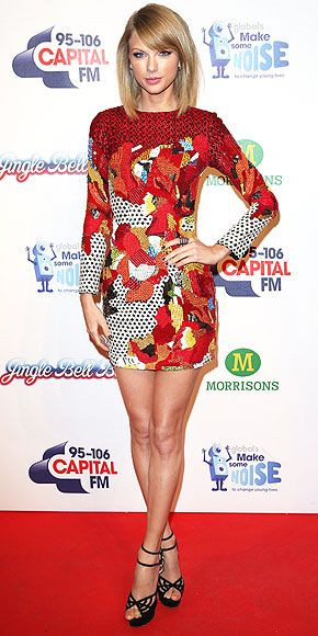 in a a multicolored long-sleeve embroidered Sachin & Babi mini and Charlotte Olympia platform sandals at the Jingle Bell Ball in London (dec 2014)