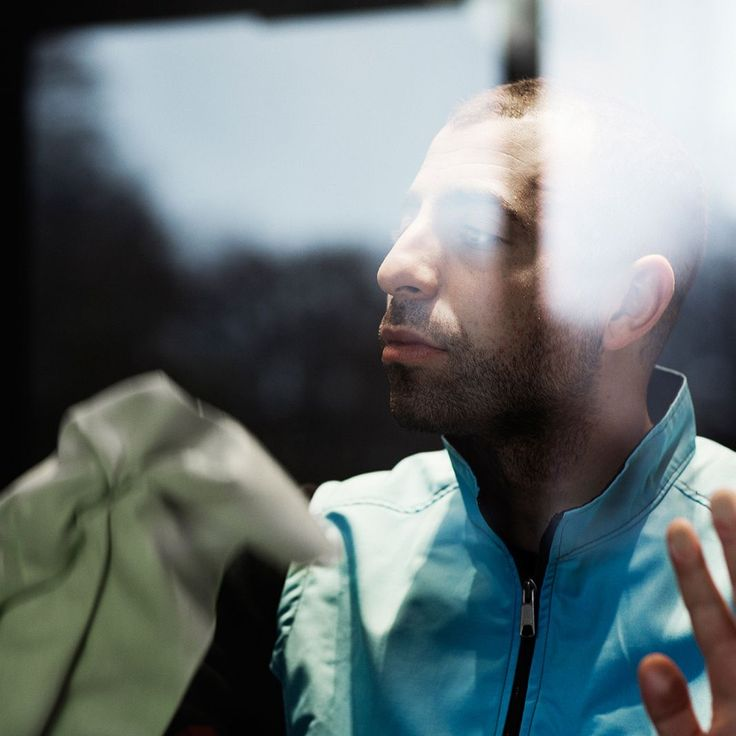 Behind glass window. Man looking out. Peaceful. Photo by Pia Inberg.