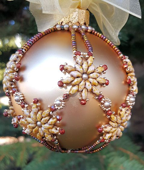 """Pattern is by Julia Gerlach called """"Snowflower ornament"""". Superduo are chalk bronze lumi (nice colour).3mm. pearls platinium.2mm fire-polished red goldenrod.15/0 Miyuki 1052 and 11/0 Miyuki 462.Beaded ornaments is not my thing but the D-I-Law loves them. This pattern is very easy to follow but it is very difficult to assemble. I will never make another one and my husband is happy to hear that. LOL. It's very pretty tho."""