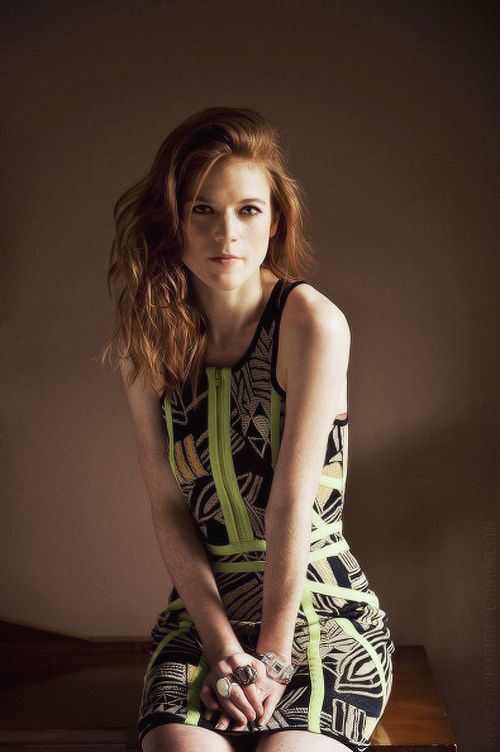 Form-fitting, but not obscene, dress. Rose Leslie (Ygritte) looks quite pretty as she kneels.