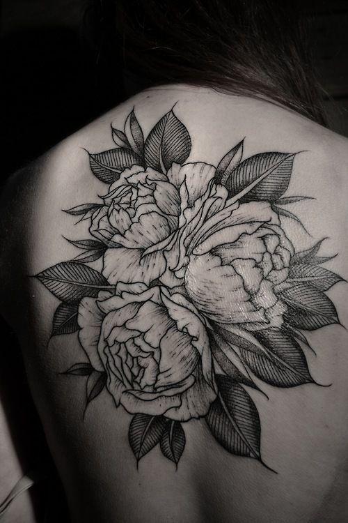 black flower tattoo