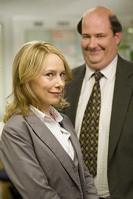 Amy Ryan as Holly Flax and Brian Baumgartner as Kevin Malone.