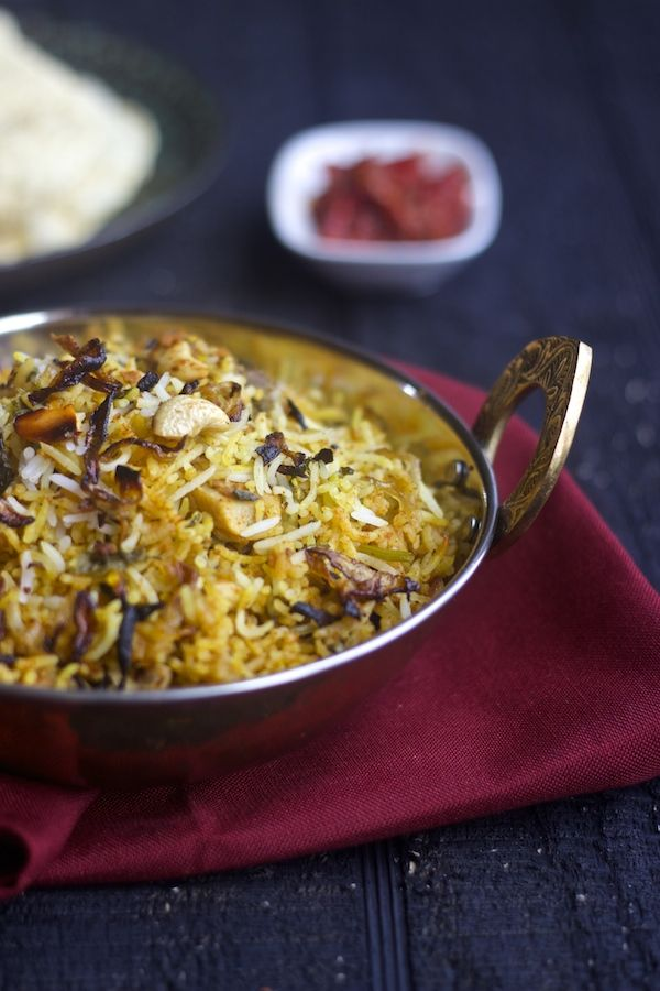 Chicken Biriyani - An Indian one pot meal Chicken is marinated with yogurt and spices, then cooked, topped with layers of rice and herbs. http://www.feedyourtemptations.com/chicken-dum-biriyani/