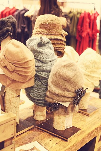 logs screwed to wood bases makes for an interesting hat display.                                                                                                                                                                                 More