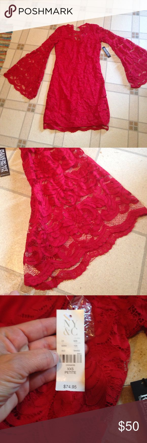 Beautiful red lace flare sleeve dress Beautiful red lace flare sleeve dress from New York and company brand new with tags has a red lining and back zipper size extra extra small petite smoke-free pet free home New York & Company Dresses