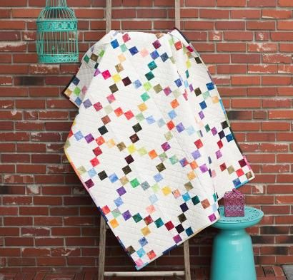 Designed by Nancy Smith exclusively for Craftsy, Candy Squares couldn't be a simpler quilt to make! All nine patches are stitched with ease. With a 100-pc charm pack and 3 yards of Kona Snow includ...