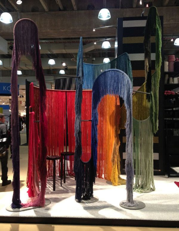 Tanya Aguiñiga partnered with Kasthall to create an installation to show the range of Kasthall's rainbow-like collection of yarn colors.