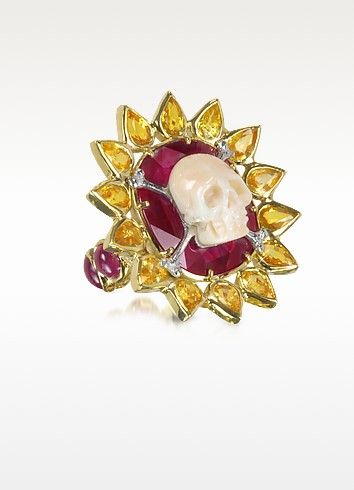 €11800.00   Polished 18-karat gold skull bone ring surrounded by a sunflower design with sixteen petal-shaped yellow sapphires. Featuring six cabochon cut rubies around band. Slip-on design. Other sizes are available upon request. Made in Italy.Note: GOLD 24.10gr (18K), 1RUBY 30.42ct, 6RUBY 8.12ct, 16Y.SAFF 7.20ct