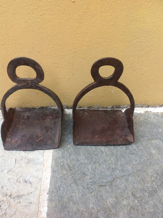 Pair of Antique Iron Stirrup Iron Forged Made from hand forged iron this very old stirrup dating from the 1700s is in good condition though has rusty patina.  Great decor for cottage chic, equestrian decor and tack room,  The stirrup measures 13 cm across the base, 18 cm in height and 13.  Thank you for visiting
