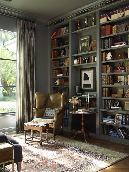 Library with painted bookshelves #antiques and #zebra #leather wingback Kate Jackson Design