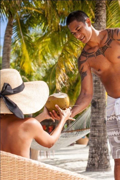 Coconuts? Yes, please! Stay cool with a refreshing coconut while enjoying the afternoon sun on the beach - at the St. Regis Bora Bora Resort