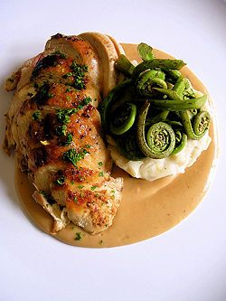 Nicely presented and simple. Sauce was poured first, chicken was sliced for easier dining and a neat mound of mashed potato and fiddleheads.