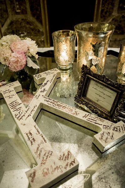 In lieu of a guest book, have guests write well-wishes on a wooden letter! {Carol Oliva Photography}