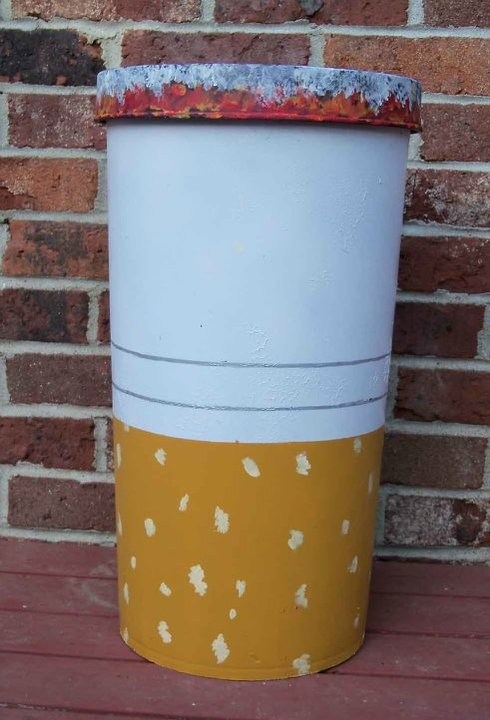 Outdoor ashtray found in a convenience store dumpster. I painted it and it is now a giant cigarette outdoor ashtray.