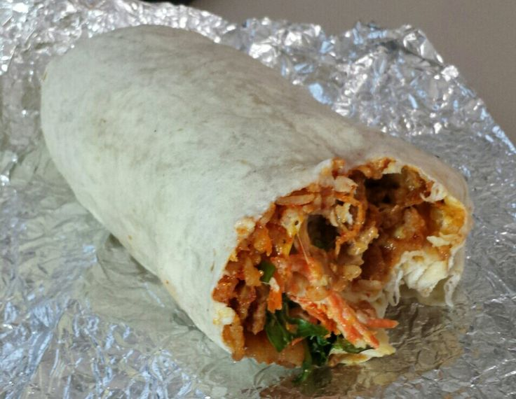 Seoul Taco - Burrito - with kimchi fried rice, lettuce, cheese, carrots, sour cream and seoul sauce with Spicy Pork