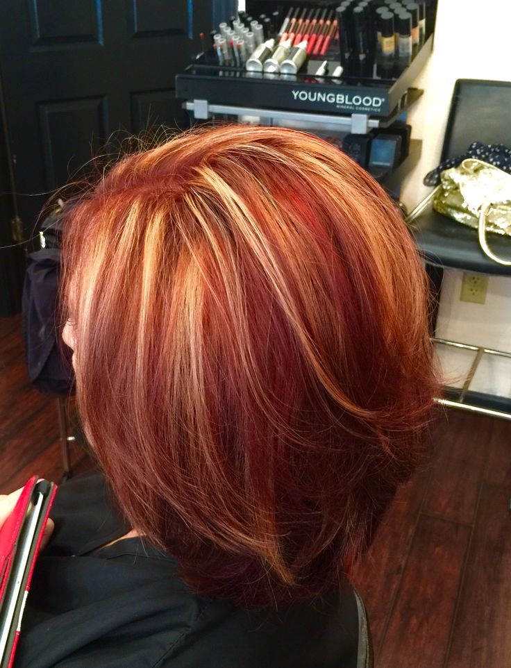 Red hair with blonde highlights by Nicole at Nicole's Beauty Box in down town St. Pete, FL