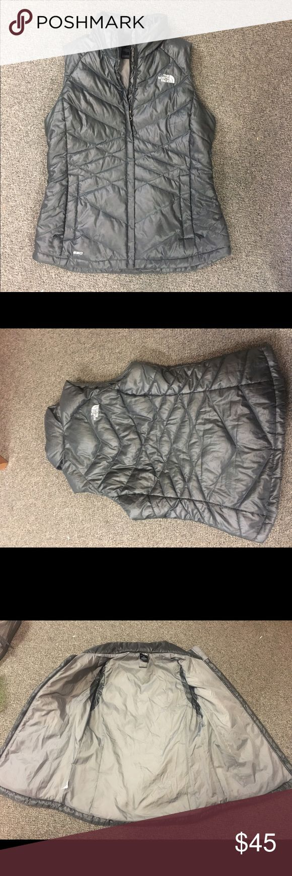 North Face Vest Medium Women's North Face vest. No holes or tears, great condition. It's a darker shade of grey, not quite black. Super comfy and keeps you really warm. North Face Jackets & Coats Vests