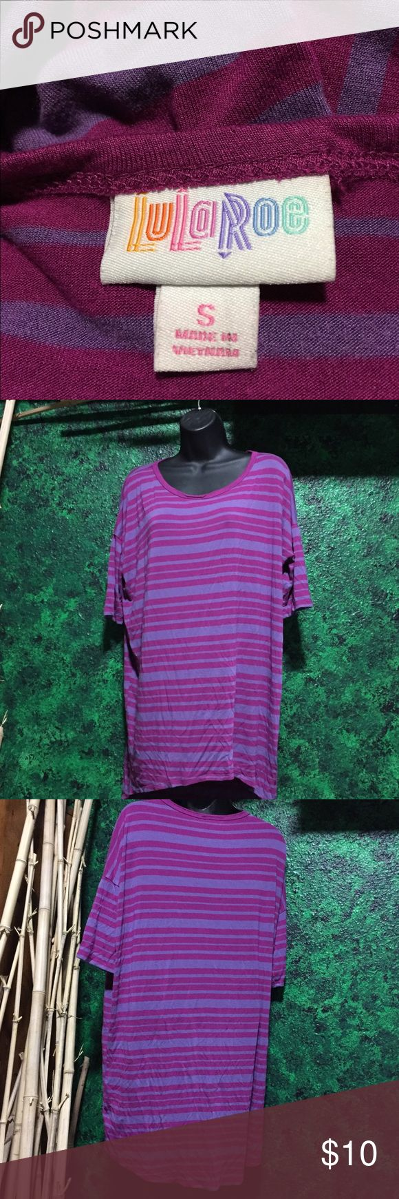 LuLa Roe Irma small purple striped shirt Cute LulaRoe flowy feel with fun color stripes! Great condition, only worn a couple times. Purple and magenta alternating stripes of various sizes. LuLaRoe Tops Tunics