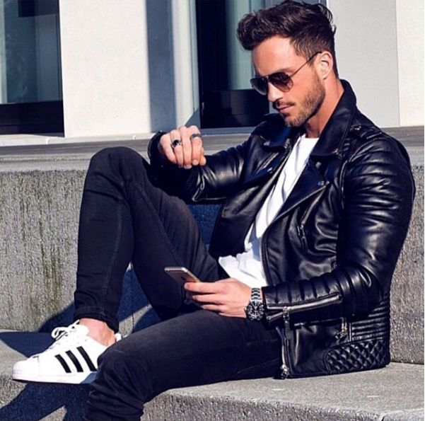 Shop this look on Lookastic:  https://lookastic.com/men/looks/biker-jacket-crew-neck-t-shirt-skinny-jeans/15035  — Silver Watch  — Black Skinny Jeans  — White and Black Athletic Shoes  — Black Quilted Leather Biker Jacket  — White Crew-neck T-shirt