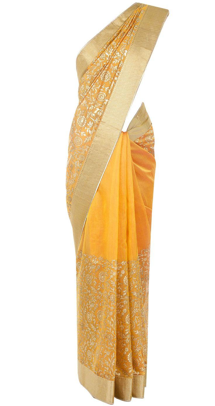 Orange wide floral print sari by ROHIT BAL. http://www.perniaspopupshop.com/designers-1/rohit-bal