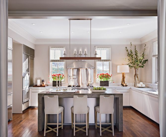 LOVE mix of marble and concrete - could do our island in marble, other counters in concrete or grey caesar stone? also like cabinets- and is that a stainless steel island under there?