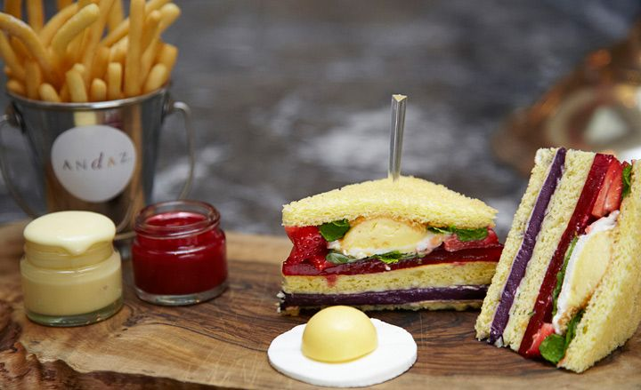dessert club sandwich, featuring doughnut fries, a lemon meringue fried egg and raspberry coulis ketchup and white chocolate mayo