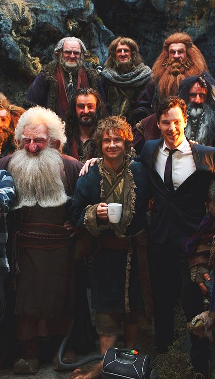 All the dwarves and Bilbo are in their adventuring clothes and then there's smaug. In his suit.