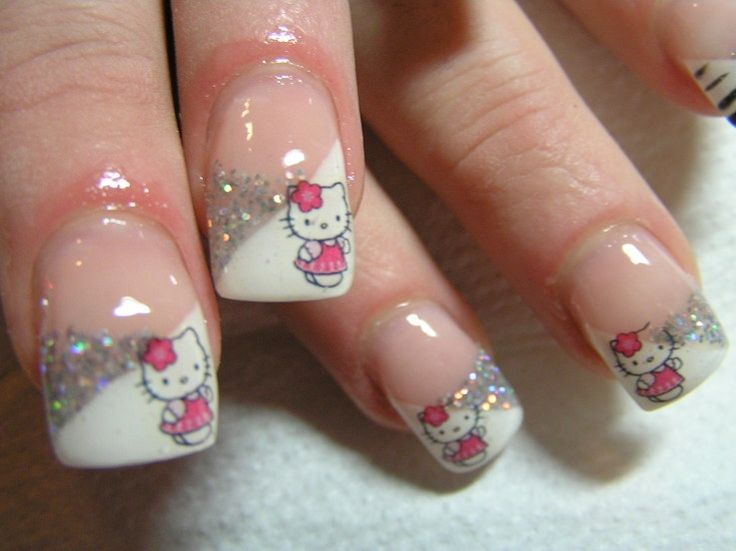 Google Image Result for http://static.becomegorgeous.com/img/arts/2010/Dec/22/3469/hello_kitty_nails_2.jpg
