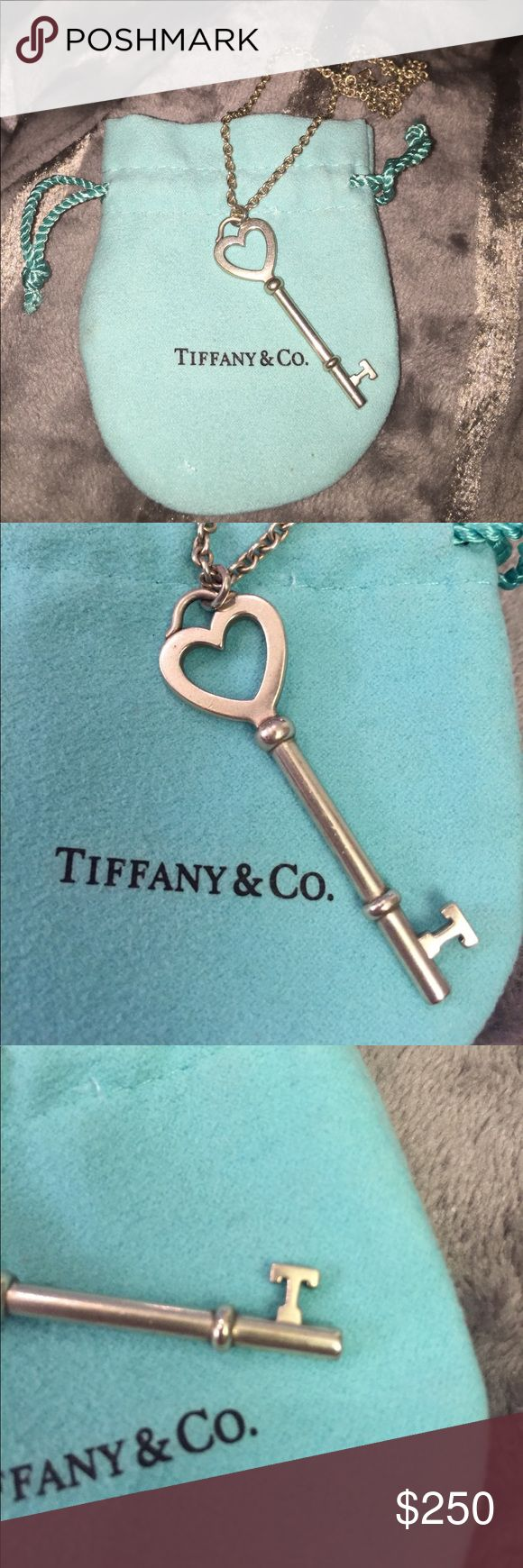 "Tiffany & Co. Sterling silver heart key necklace Tiffany & Co. Sterling silver heart key pendant necklace. Tiffany keys. Pendant measure 2"" inches - some wear/marks -no big flaws - heart shaped key with letter ""T"" detail on key - stamped with Tiffany logo and stamped 925 - Tiffany chain measures 18""- comes with Tiffany blue pouch- some discoloration on the chain. Please see pictures Tiffany & Co. Jewelry Necklaces"