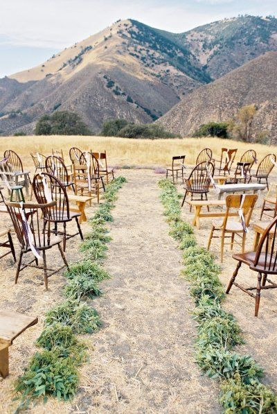 MAIN STYLE REF greenery lined aisle and mismatched chairs / benches / stools