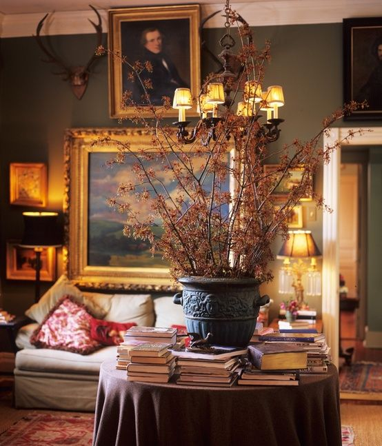 Table with books, artwork, antlers - P. Allen Smith