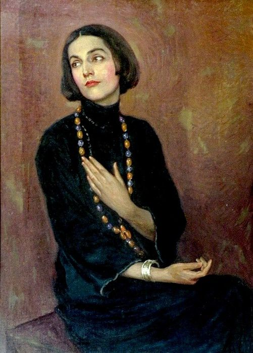 Portrait of Isadora Duncan wearing a blue dress and coloured bead necklace,1922, Paul Swan