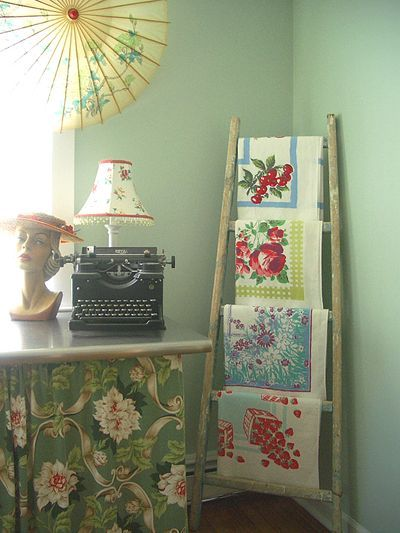 {vintage tablecloths on a ladder}