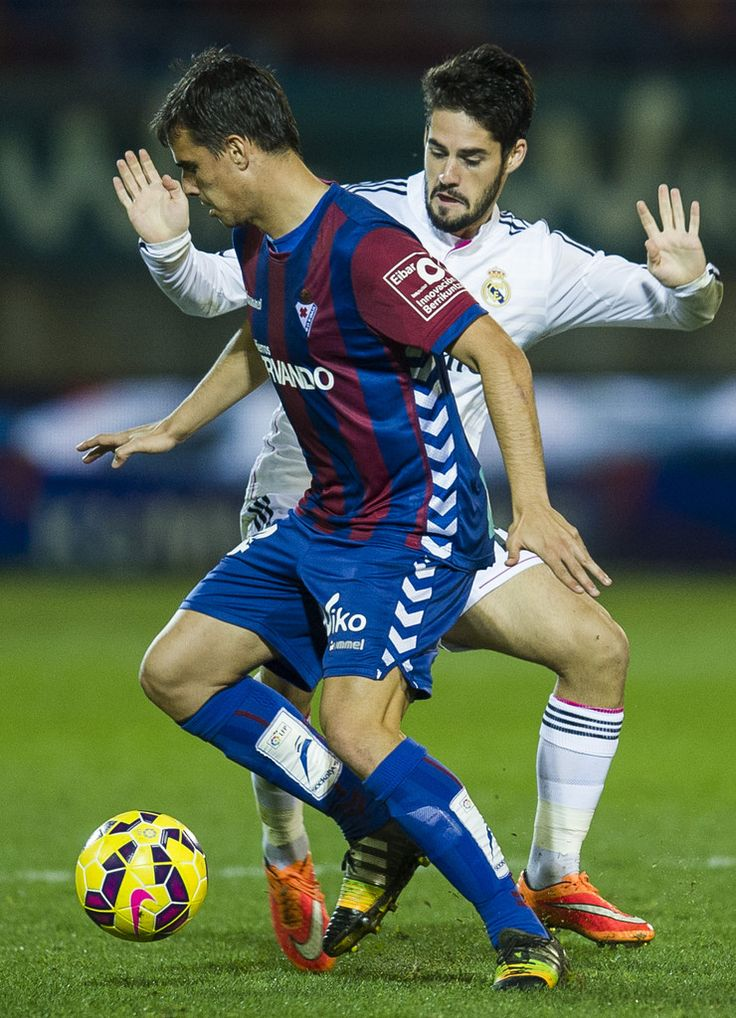 Isco of Real Madrid duels for the ball with Daniel Garcia of SD Eibar during the La Liga match between SD Eibar and Real Madrid at Ipurua Municipal Stadium on November 22, 2014 in Eibar, Spain.