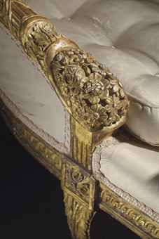 Photo of the arm on an 18th Century French giltwood duchesse brisee
