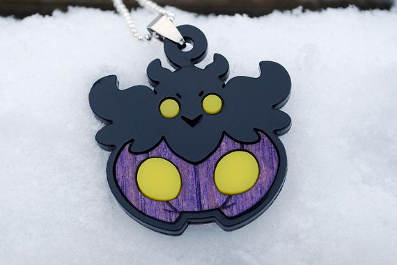 This is a pendant of (shiny!) Pumpkaboo, one of the new Ghost-type Pokemon introduced in the X and Y games. Weve given it an extra touch of chibi for extra cuteness! It's about 1.75 wide, and 1.75 tall (head-swirly to base). Most of it is made of laser-cut acrylic, but the body is made of wood - hand painted and sealed with a matte spray! It comes as a necklace on an approximately 23 long silver-coloured ball chain. Let us know in your comment whether you will want a longer length of…