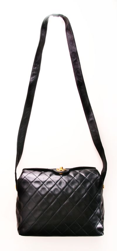 Chanel Shoulder Bag. http://fashionbagarea.blogspot.com/ We can spot a chanel clutch from a mile off. Those golden studs are set perfectly against the chic tan shade.$159 Want!