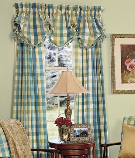 Unify your room with the vibrant colors of our Moire Plaid Balloon Valance. (Moire Plaid Lined Balloon Valance with Fringed Trim. Available in Blue, Natural and Rose.)