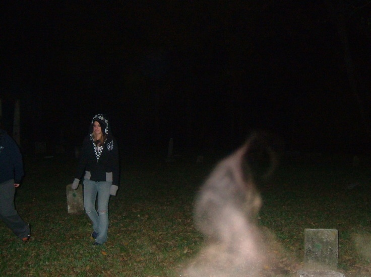 Photo of a White Lady, taken at Riverside Cemetary, Indiana (USA) on Nefarious Noblesville Ghost Tour. - could also be cigarette smoke.