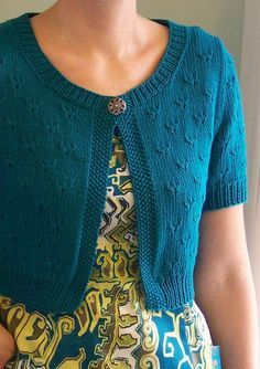"Free knitting pattern for Little Peacock Cardigan - I love this stitch! Sarah Hoadley designed this cute cropped short-sleeved cardigan sweater around a stitch pattern from Harmony Guides – Knit and Purl. Finished Bust Size 31 (35, 39, 43, 47, 51)"" to fit bust 30 (34, 38, 42, 46, 50)""."
