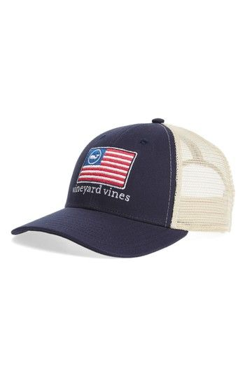 908ee960fde1b3 An meshback trucker cap fitted with an adjustable hook-and-loop strap  retains the classic Americana look with custom flag embroidery.