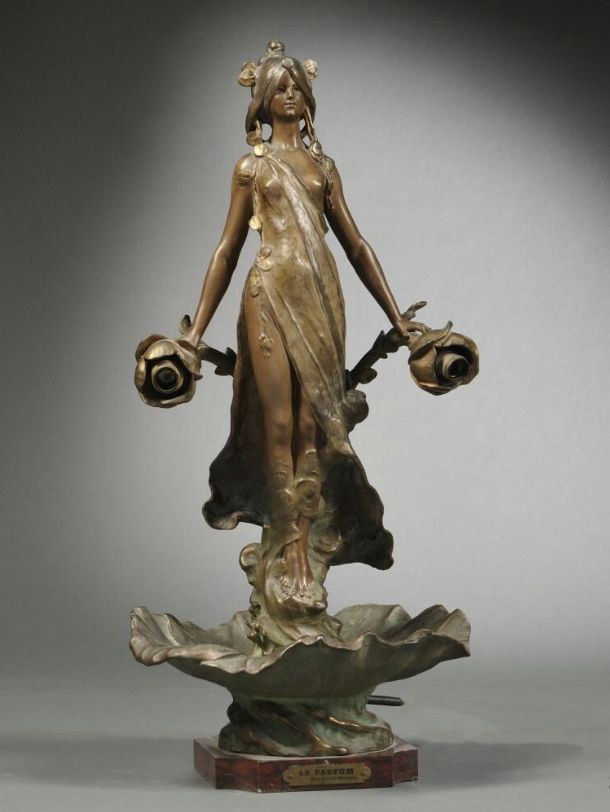 An Art Deco patinated spelter table lamp, early 20th