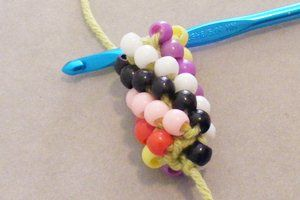 Perfect!  Step-by-step tutorial on crocheting a beaded rope.  She uses big pony beads for the practice rope so that you can see the individual stitches. Even I can do this! from making-beaded-jewelry.com