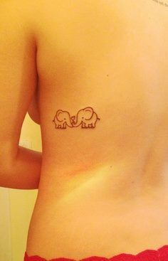 Little elephant tattoo; this design on my hip, and as I have children each one gets added across my lower tummy.