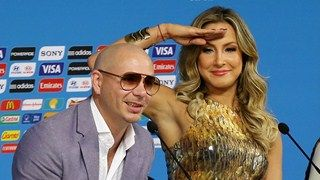 Brazilian singer Claudia Leitte joins US rapper Pitbull in a press conference