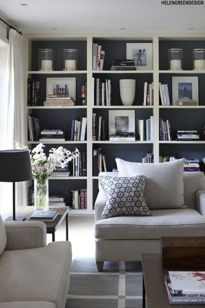 Family room - Dark Bookshelves (dark cupboard doors too) with white trim Interiors Trend