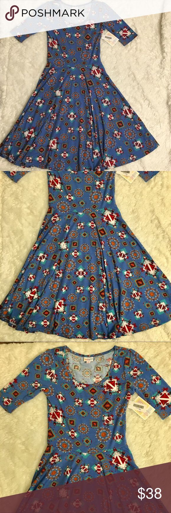 Lularoe Nicole Blue Geometric Aztec Print Dress Lularoe Nicole Blue Geometric Aztec Print Dress. New with tags. Size Small. Fast shipping. Smoke free and pet free home. No trades or modeling. Bundle to save. Offers welcome! LuLaRoe Dresses