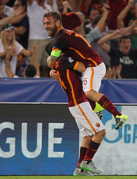 Alessandro Florenzi (L) with his teammate Daniele De Rossi of AS Roma celebrates after scoring the team's first goal during the UEFA Champions League Group E match between AS Roma and FC Barcelona at Stadio Olimpico on September 16, 2015 in Rome, Italy.